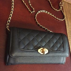 Black. No brand. Crossbody clutch.